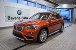 This Orange 4 door xDrive28i SUV features a Black interior a 8 Spd Automatic transmission, a  2.0L  I 4 engine, and has 90 kilometres on it.