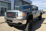 This Grey 4 door SLE Pickup features  a 6 Spd Automatic transmission, a  6.0L  V 8 engine, and has 66512 kilometres on it.