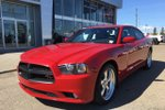 This Red 4 door R/T Sedan features  a 5 Spd Automatic transmission, a  5.7L  V 8 engine, and has 58459 kilometres on it.