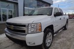 This White 4 door WT - 4x4! Crew Cab, Short Box Pickup features a Grey interior a 4 Spd Automatic transmission, a  5.3L  V 8 engine, and has 149666 kilometres on it.