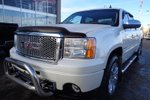 This White 4 door Denali Pickup features  a 6 Spd Automatic transmission, a  6.2L  V 8 engine, and has 218167 kilometres on it.