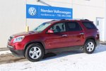 This Dark Red 4 door SLE SUV features a Grey interior a 6 Spd Automatic transmission, a  3.6L  V 6 engine, and has 144600 kilometres on it.
