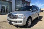 This Silver 4 door Base SUV features  a 6 Spd Automatic transmission, a  5.4L  V 8 engine, and has 116443 kilometres on it.