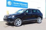 This Black 4 door 3.6L Highline 4dr All-wheel Drive 4MOTION SUV features a Black interior a 8 Spd Automatic transmission, a  3.6L  V 6 engine, and has 16 kilometres on it.