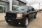 This Black 4 door Denali Pickup features  a 6 Spd Automatic transmission, a  6.6L  V 8 engine, and has 131300 kilometres on it.