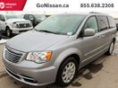This Silver 4 door LX Passenger Van features a Black interior a Automatic transmission, a  3.6L  V 6 engine, and has 48656 kilometres on it.