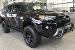 This Black 4 door Trail Edition 4x4 Factory Remote Starter, Gateway Extreme Package, Cross Bars SUV features a Black interior a 5 Spd Automatic transmission, a  4.0L  V 6 engine, and has 10 kilometres on it.