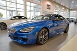 This Blue 4 door xDrive Gran Coupe Sedan features  a 8 Spd Automatic transmission, a  4.4L  V 8 engine, and has 90 kilometres on it.