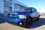 This Blue 4 door SLT Turbo Diesel Pickup features  a 8 Spd Automatic transmission, a  3.0L  V 6 engine, and has 76000 kilometres on it.
