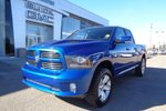 This Blue 4 door Sport Pickup features a Black interior a 8 Spd Automatic transmission, a  5.7L  V 8 engine, and has 63000 kilometres on it.
