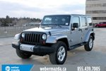 This Silver 4 door Sahara Unlimited SUV features  a Automatic transmission, a  3.6L  V 6 engine, and has 81221 kilometres on it.