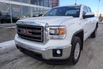 This White 4 door SLE Pickup features  a 6 Spd Automatic transmission, a  5.3L  V 8 engine, and has 95311 kilometres on it.