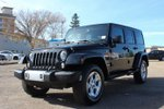 This Black 4 door Sahara 4X4 - HARDTOP - AUTO - LOW KM - FINANCE !! NO FEES SUV features  a Automatic transmission, a  3.6L  V 6 engine, and has 48016 kilometres on it.