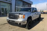 This Silver 4 door SLE Pickup features  a Automatic transmission, a  5.3L  V 8 engine, and has 110086 kilometres on it.