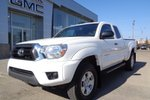 This White 4 door V6 - 4x4! LOW KM's! Pickup features a Grey interior  a  4.0L  V 6 engine, and has 9785 kilometres on it.