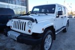This White 4 door Sahara - 4x4! Topless Fun! SUV features  a 6 Spd Manual transmission, a  3.6L  V 6 engine, and has 54789 kilometres on it.