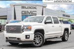 This White 4 door Denali Pickup features  a 6 Spd Automatic transmission, a  6.2L  V 8 engine, and has 107190 kilometres on it.