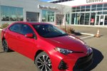 This Red 4 door SE Upgrade Package 4dr Sedan Sedan features a Black interior a CVT transmission, a  1.8L  I 4 engine, and has 0 kilometres on it.