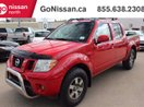 This Red 4 door PRO-4X 4x4 Crew Cab LEATHER, SUNROOF, HEATED SEATS Pickup features a Black interior a 5 Spd Automatic transmission, a  4.0L  V 6 engine, and has 87854 kilometres on it.