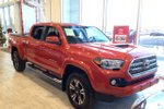 This Red 4 door Demo TRD Sport Upgrade Tonneau Cover, Side Step Bars Pickup features a Black interior a 6 Spd Automatic transmission, a  3.5L  V 6 engine, and has 0 kilometres on it.