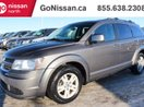This Grey 4 door CVP/SE Plus 4dr Front-wheel Drive SUV features a Grey interior a 4 Spd Automatic transmission, a  2.4L  I 4 engine, and has 88750 kilometres on it.