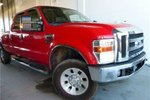 This Red 4 door Lariat Pickup features  a Automatic transmission, a  NoneL  V 8 engine, and has 119303 kilometres on it.
