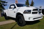 This White 4 door Sport 4x4 Quad Cab Pickup features a Black interior a 8 Spd Automatic transmission, a  5.7L  V 8 engine, and has 5617 kilometres on it.