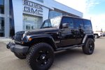 This Black 4 door Sahara - 4x4! Year Around Excitement! SUV features  a 5 Spd Automatic transmission, a  3.6L  V 6 engine, and has 25282 kilometres on it.