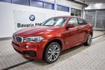 This Red 4 door xDrive50i SUV features  a 8 Spd Automatic transmission, a  4.4L  V 8 engine, and has 90 kilometres on it.