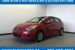 This Red 4 door - Hatchback features a Black interior a Automatic transmission, a  1.6L  I 4 engine, and has 14496 kilometres on it.