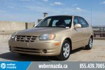 This Gold 4 door Base Hatchback features a Gray interior a Automatic transmission, a  1.6L  I 4 engine, and has 132566 kilometres on it.
