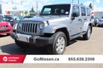 This Silver 4 door Sahara 4x4 SUV features a Black interior a 5 Spd Automatic transmission, a  3.6L  V 6 engine, and has 67730 kilometres on it.