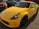 This Yellow 2 door Base 2dr Rear-wheel Drive Coupe Coupe features a Black interior a 6 Spd Manual transmission, a  3.7L  V 6 engine, and has 5 kilometres on it.