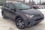 This Grey 4 door LE 4dr All-wheel Drive Upgrade Package - Demo SUV features a Black interior a 6 Spd Automatic transmission, a  2.5L  I 4 engine, and has 0 kilometres on it.
