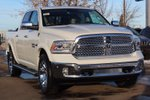 This None 4 door Laramie Pickup features  a 8 Spd Automatic transmission, a  5.7L  V 8 engine, and has 13 kilometres on it.
