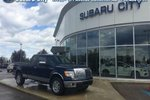 This Blue 4 door XLT 4X4 Extended Cab - $198.24 b/w* Pickup features a Beige interior a 6 Spd Automatic transmission, a  5.4L  V 8 engine, and has 131165 kilometres on it.