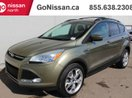 This Green 4 door SE: ECO BOOST, 19 INCH ALLOYS, BACK UP CAMERA, HEATED SEATS, SUV features a Grey interior a 6 Spd Automatic transmission, a  2.0L  I 4 engine, and has 152005 kilometres on it.