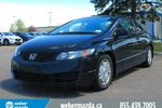 This Black 2 door DX-G - LOW KM'S - NO FEES - GREAT VALUE Coupe features a Grey interior a 5 Spd Automatic transmission, a  1.8L  I 4 engine, and has 74902 kilometres on it.