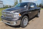 This Grey 4 door Laramie 4x4 Crew Cab Pickup features  a 8 Spd Automatic transmission, a  5.7L  V 8 engine, and has 8683 kilometres on it.