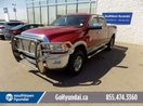 This Red 4 door Leather/Sunroof/Backup Camera Pickup features a Beige interior a 6 Spd Automatic transmission, a  6.7L  I 6 engine, and has 159566 kilometres on it.