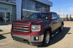 This Red 4 door SLE Pickup features  a 6 Spd Automatic transmission, a  5.3L  V 8 engine, and has 56211 kilometres on it.