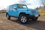 This Blue 4 door Sahara 4x4 SUV features a Black interior a 5 Spd Automatic transmission, a  3.6L  V 6 engine, and has 33 kilometres on it.