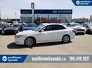 This White 4 door WRX/AWD/5SPD/HEATED SEATS Sedan features a Black interior a Manual transmission, a  2.5L  H 4 engine, and has 159599 kilometres on it.