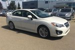 This White 4 door - 125.13 B/W - $156.29 b/w* Sedan features a Black interior a Automatic transmission, a  2.0L  H 4 engine, and has 23061 kilometres on it.