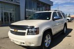 This White 4 door LTZ SUV features  a 6 Spd Automatic transmission, a  5.3L  V 8 engine, and has 48334 kilometres on it.