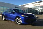 This Blue 4 door LE Upgrade Pkg. 4dr Sedan Sedan features a Black interior a 8 Spd Automatic transmission, a  2.5L  I 4 engine, and has 0 kilometres on it.