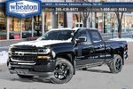 This Black 4 door Silverado Custom Pickup features a Grey interior a 6 Spd Automatic transmission, a  4.3L  V 6 engine, and has 4 kilometres on it.