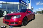 This Red 4 door SX Sedan features a Grey interior a CVT transmission, a  2.4L  I 4 engine, and has 48478 kilometres on it.