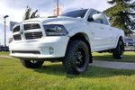 This White 4 door Sport 4x4 Quad Cab Pickup features a Black interior a 8 Spd Automatic transmission, a  5.7L  V 8 engine, and has 62 kilometres on it.