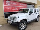This White 4 door Sahara 4x4 SUV features a Black interior a 5 Spd Automatic transmission, a  3.6L  V 6 engine, and has 7 kilometres on it.